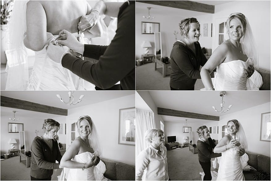 bride putting on her dress ready for her wedding at Carlyon Bay Hotel