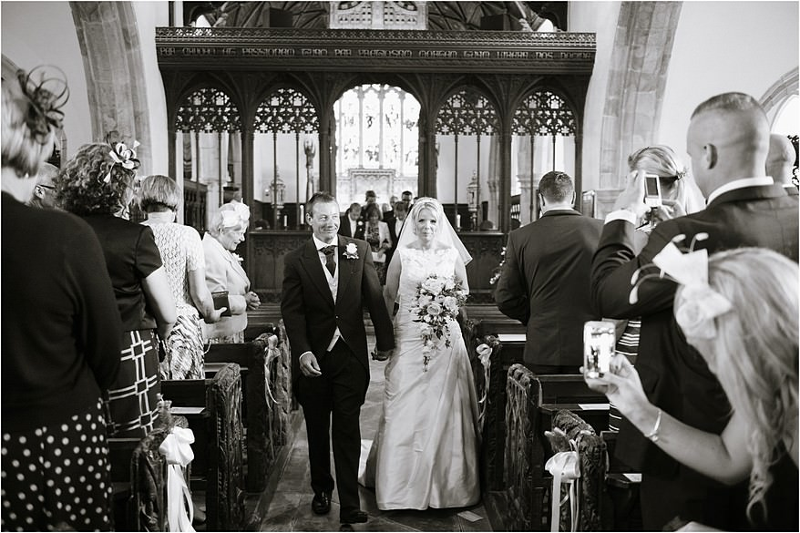 Bride walking down the isle at St Columb church wedding