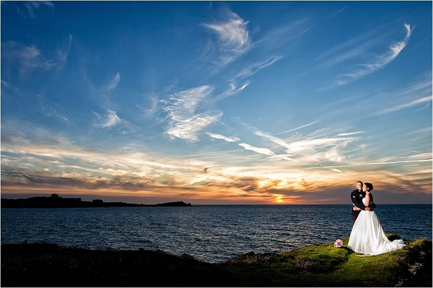 Beautiful sunset over newquay with the bride and groom