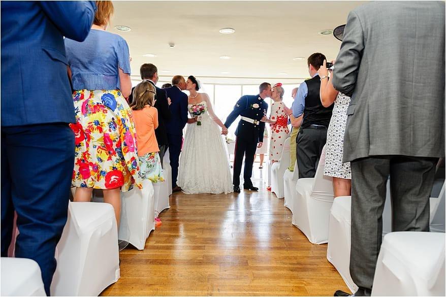 Bride & Groom walking down the aisle at the glendorgal hotel
