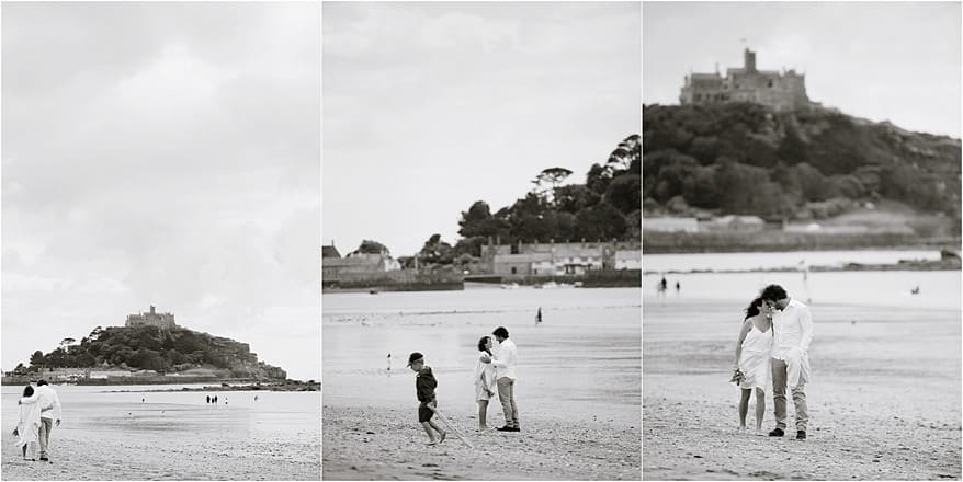 Bride and groom on the beach with St Michaels Mount