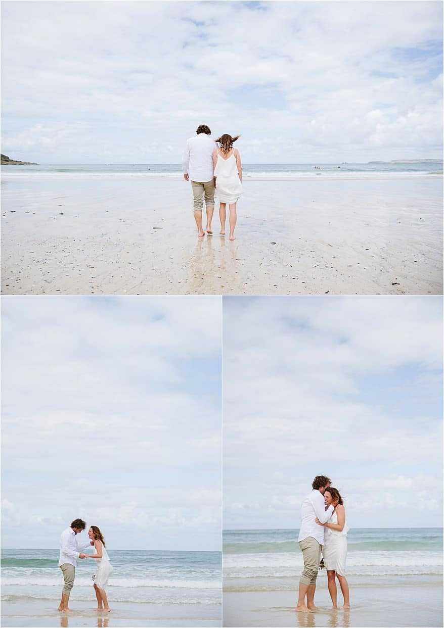 wedding couple paddling their feet at carbis bay hotel beach