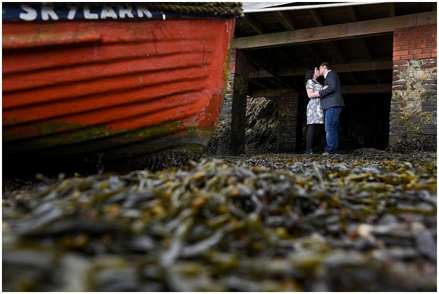 engaged couple kissing on their cornwall pre wedding shoot