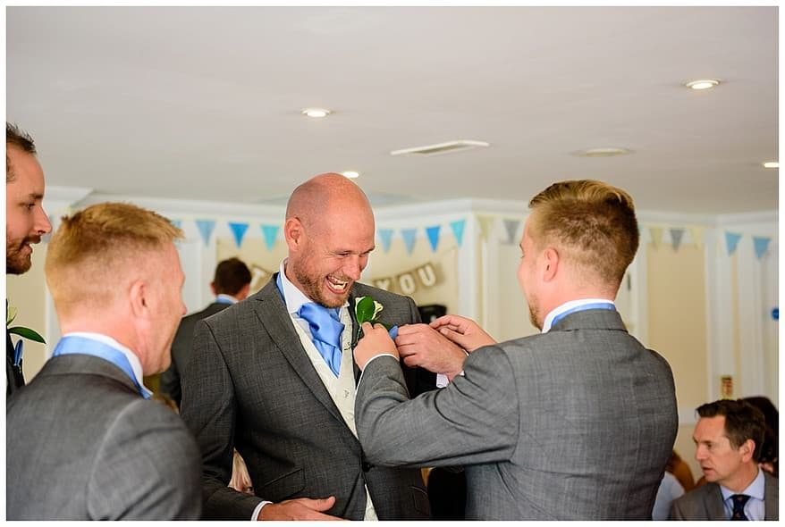 Groomsmen getting ready for a wedding at the Greenbank Hotel