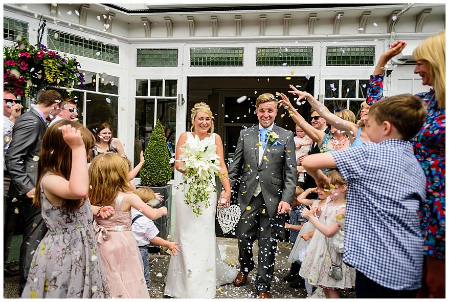 Confetti being thrown for a wedding at the Greenbank hotel