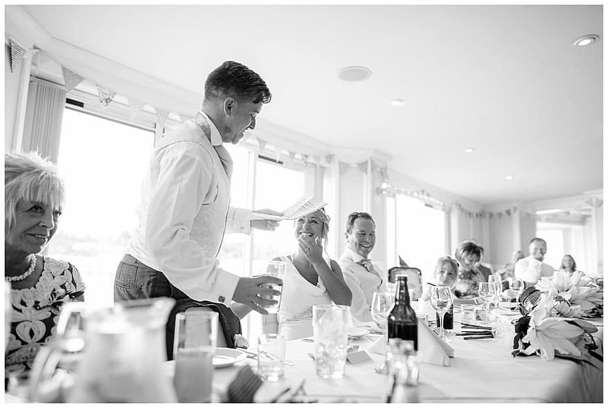 Bride laughing at the grooms speech at the greenbank hotel