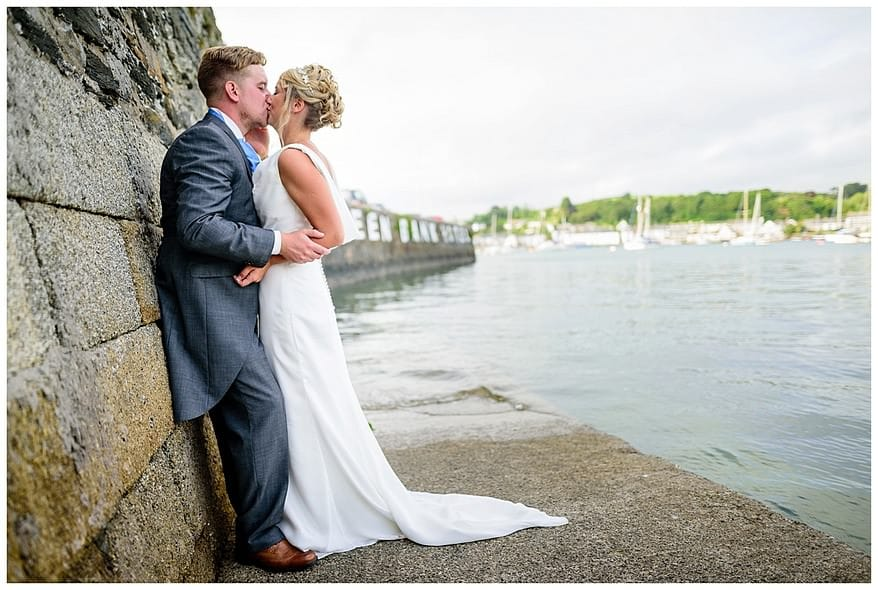 bride and groom at the greenbank hotel pier