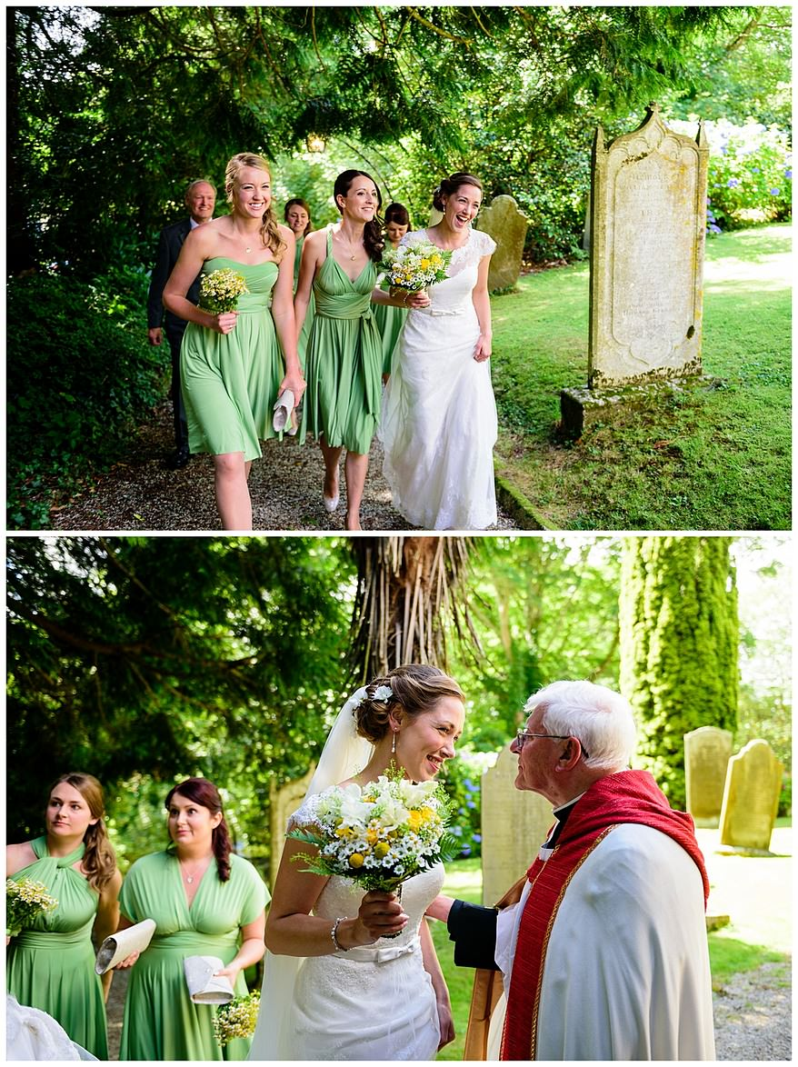 Bride and bridesmaids meeting the vicor at Perranwell Church
