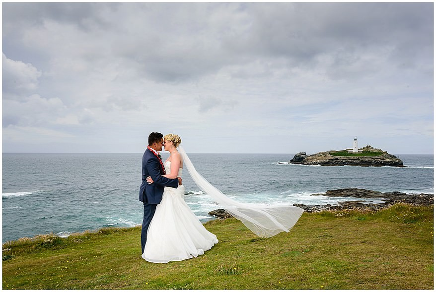 Wedding photographs with Godrevy lighthouse in the background