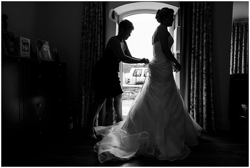 Black and white photographs of bride and her mother getting ready.