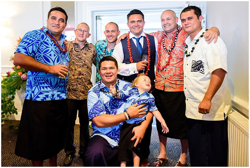 Guys dressed in kukui nut necklace and tatau print shirts