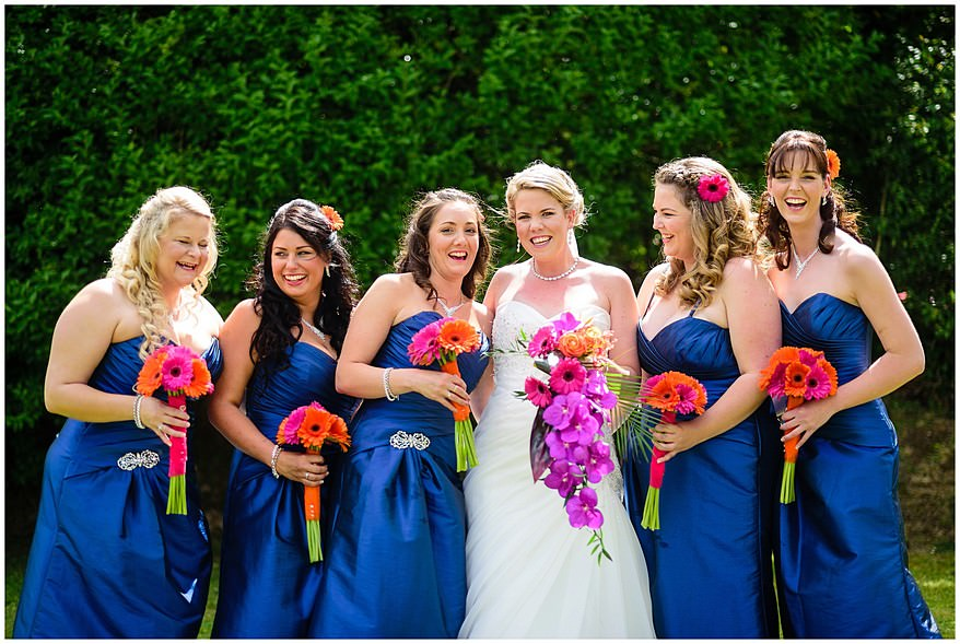 Bride with her bridesmaids just before the wedding at Merchants manor