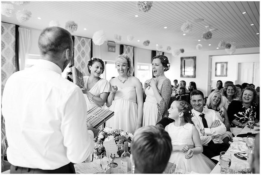 bridesmaids laughing during the wedding speeches at the carbis bay hotel