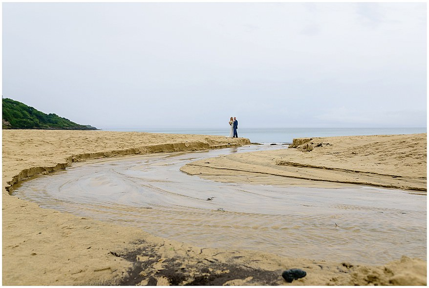 bride and groom portraits on carbis bay beach