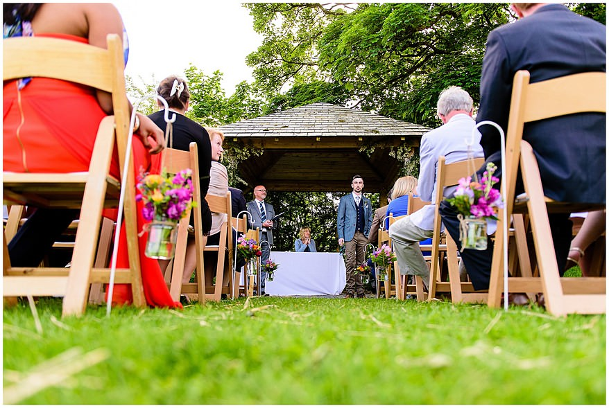 Groom waiting for his bride at Trevenna barns Arbour
