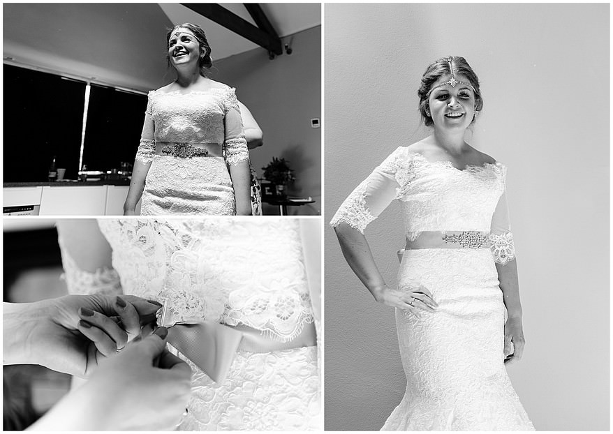 Bride being photographed by a Trevenna Barns wedding photographer