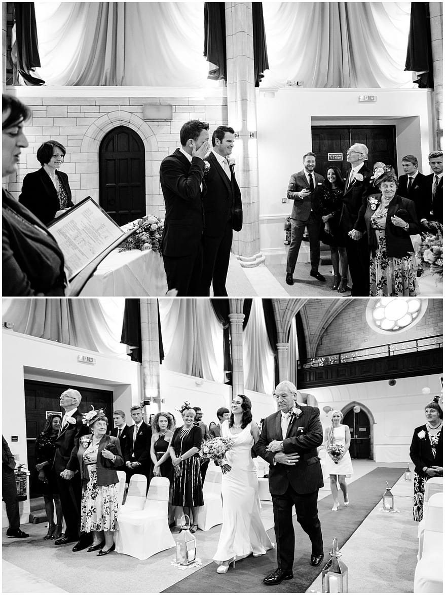 bride walking down the aisle in the great hall at the alverton hotel