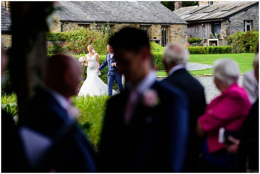 bride walking on the lawn at trevenna barns