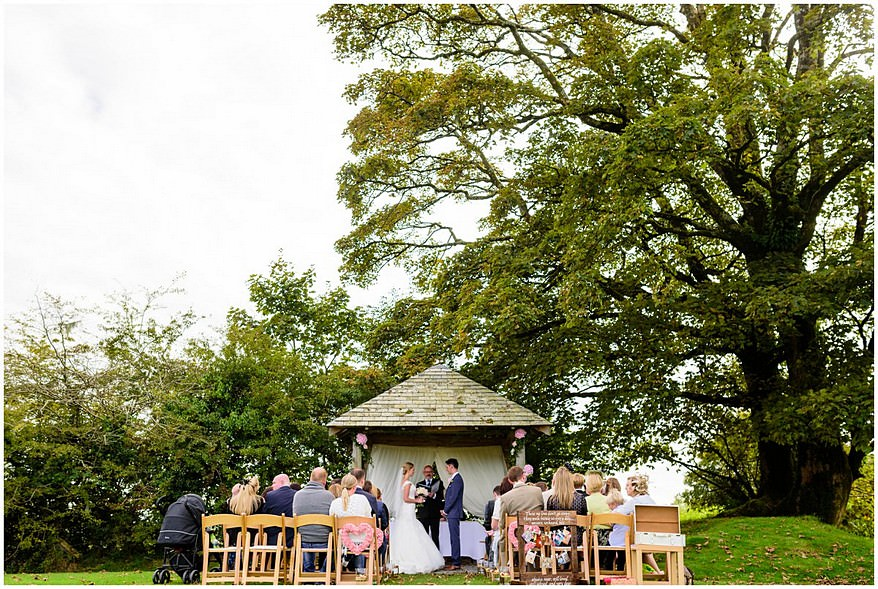 outside wedding ceremony at trevenna barns