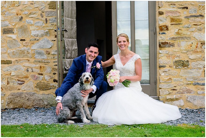 bride and groom with their dog at Trevenna barns
