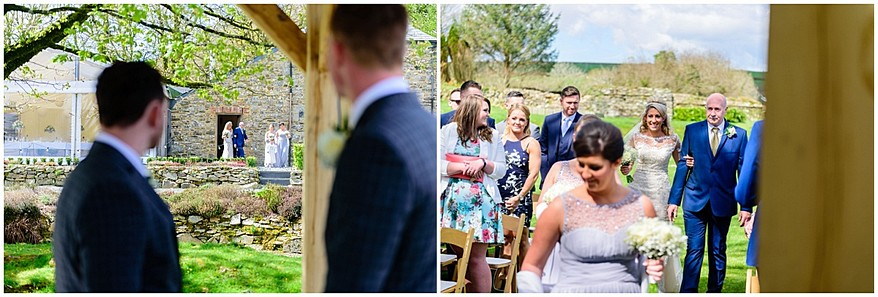 bride walking down the aisle at trevenna barns 27