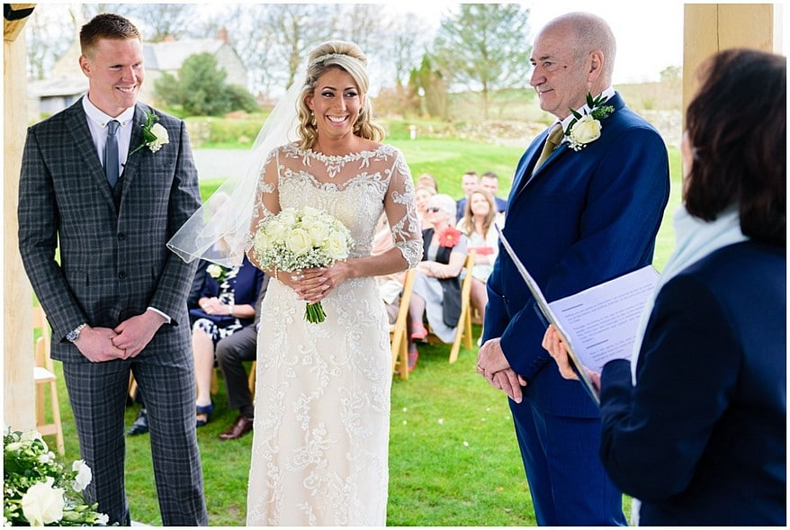 bride under the new arbour at trevenna barns 28