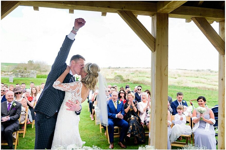 happy bride and groom at trevenna barns in cornwall 33