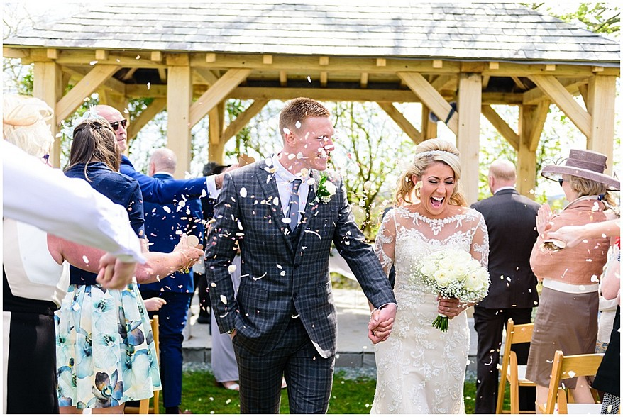 confetti down the aisle at trevenna barns in cornwall 35