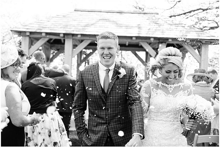 big smiles during the confetti at trevenna barns 36