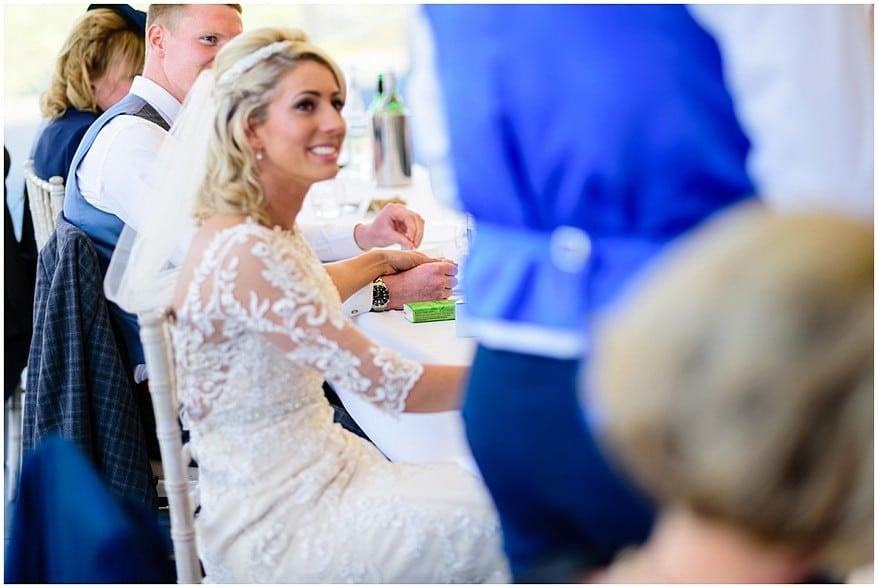 holding hands at trevenna barns wedding in bodmin 47