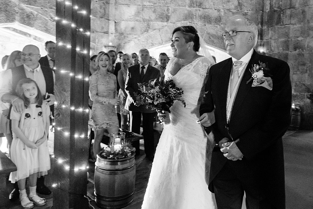 Bride walking down the aisle at Pendennis Castle 32