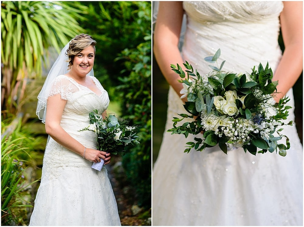 Beautiful bride with her wedding flowers before her wedding at Pendennis Castle