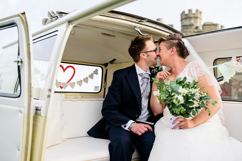 Bride and groom inside a vintage vw camper van at Pendennis Castle 71