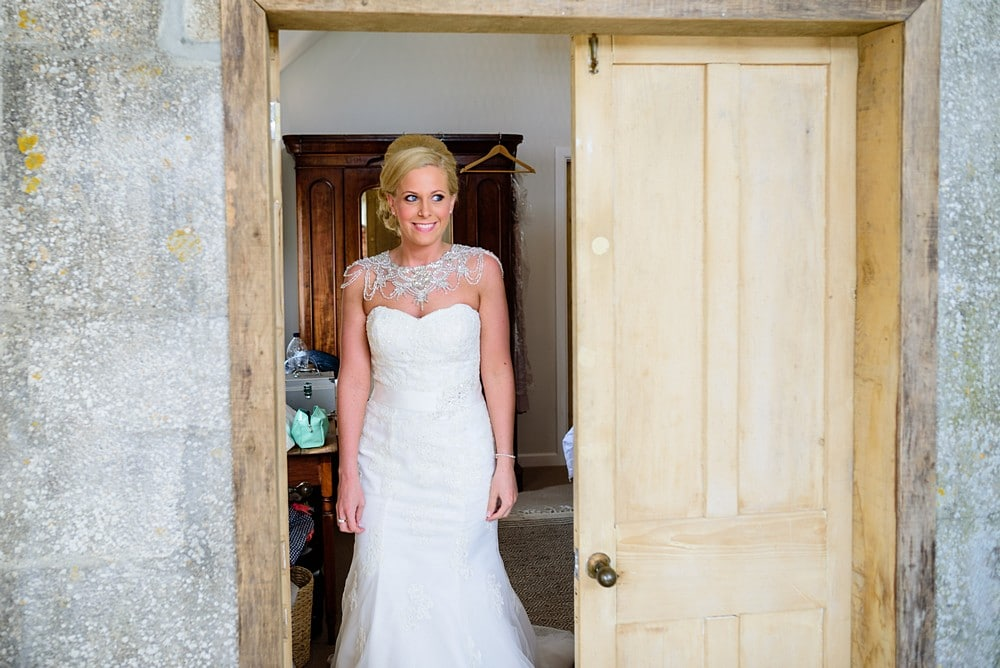 Bride in her wedding dress for the first time at Nancarrow Farm 15