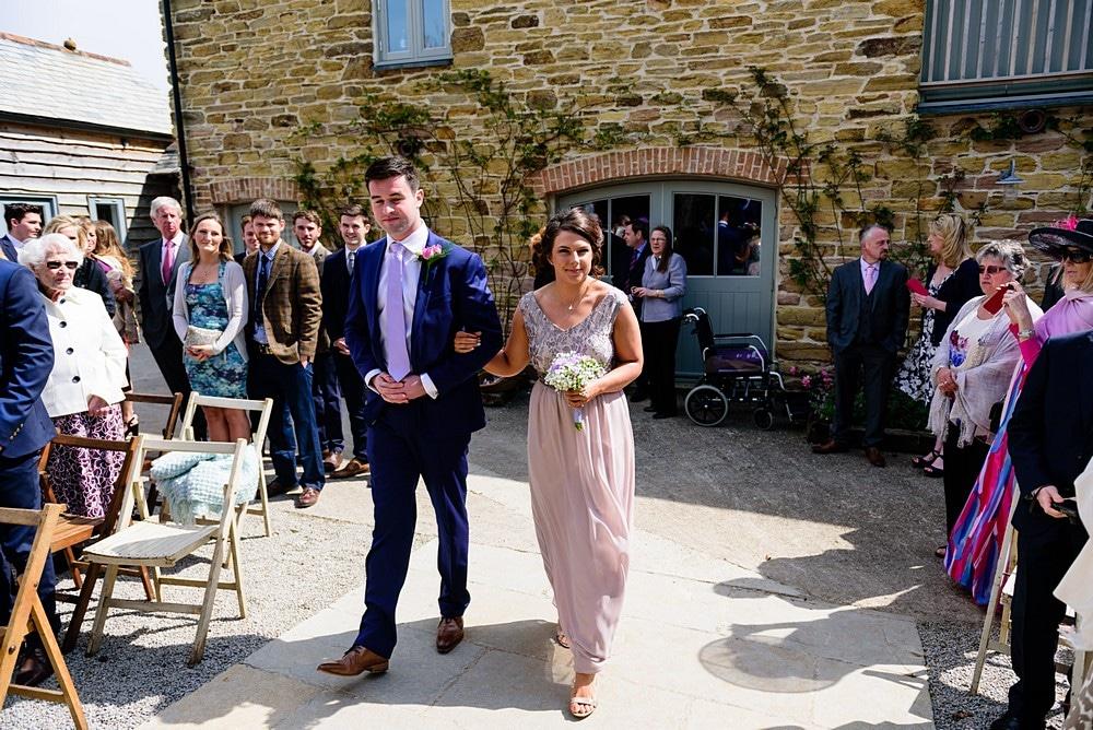 Stunning bridesmaids walking down the aisle at a Nancarrow Farm wedding 24