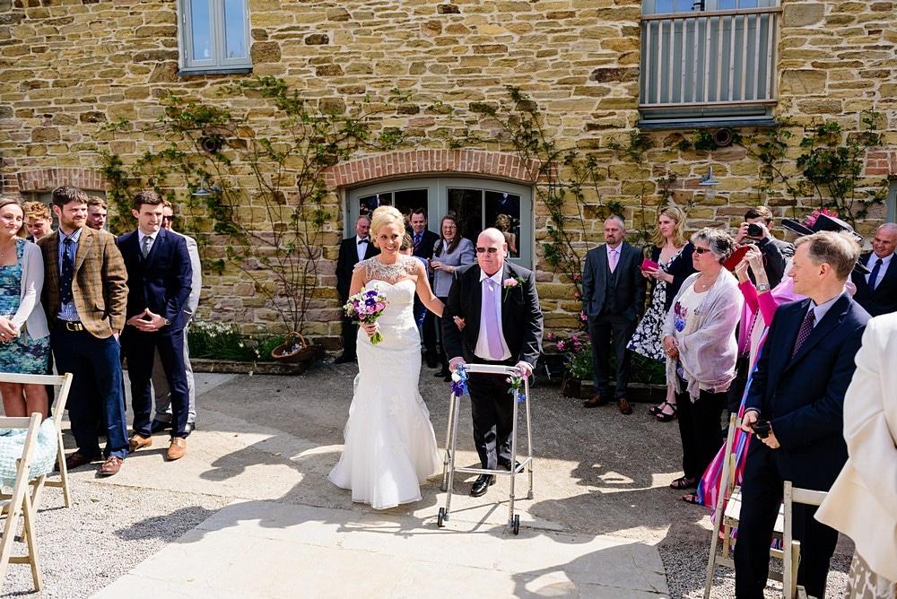Bride walking down the aisle at Nancarrow Farm 25