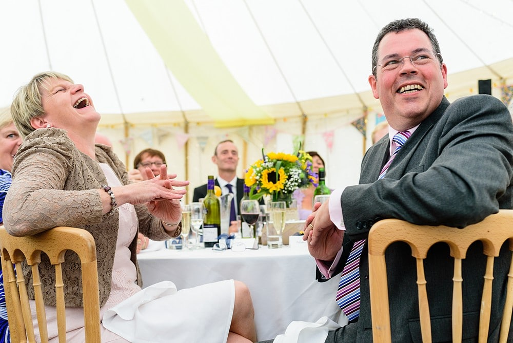 Laughing wedding guests at a Prideaux Place wedding 131