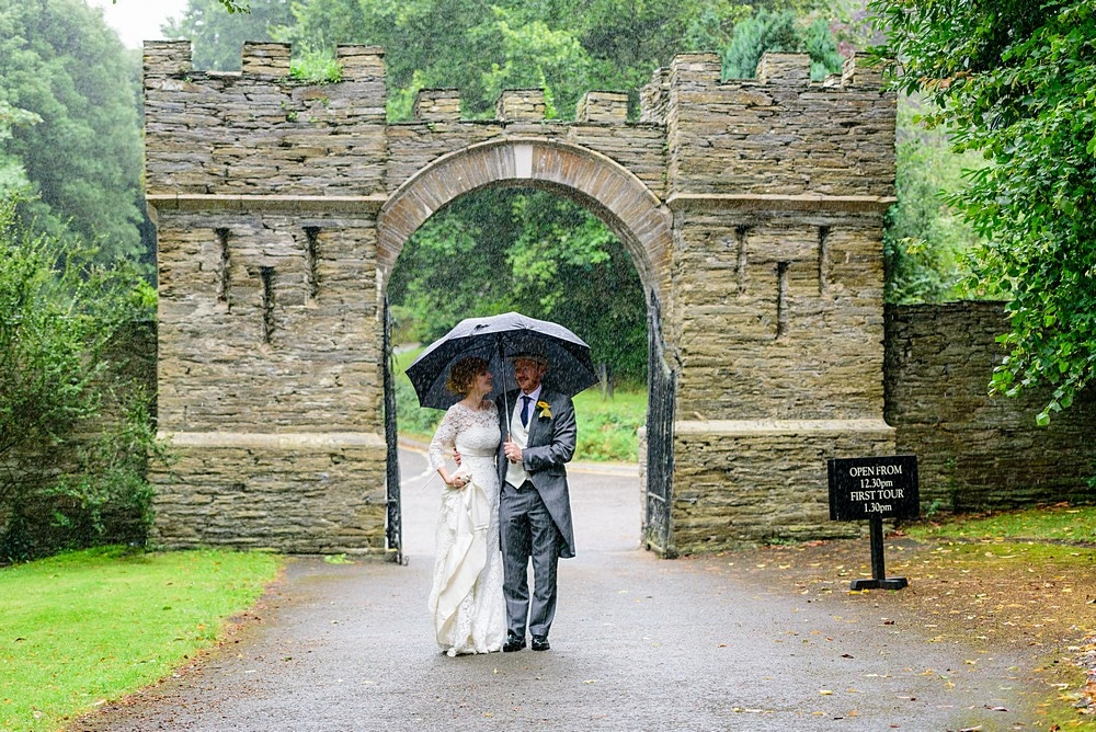 Pouring with rain at a Prideaux Place wedding 147