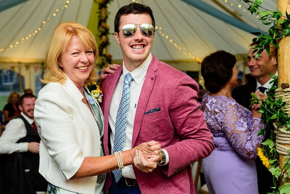 Wedding guests dancing in a marquee at Prideaux Place 155