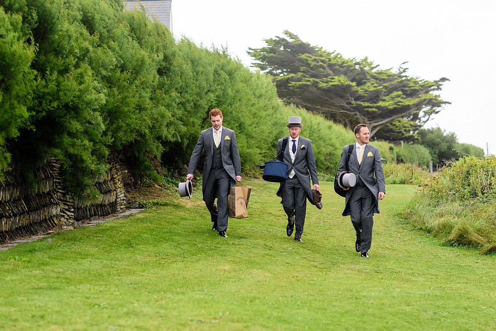 grooms walking to St Enodoc's Church inTrebetherick 21