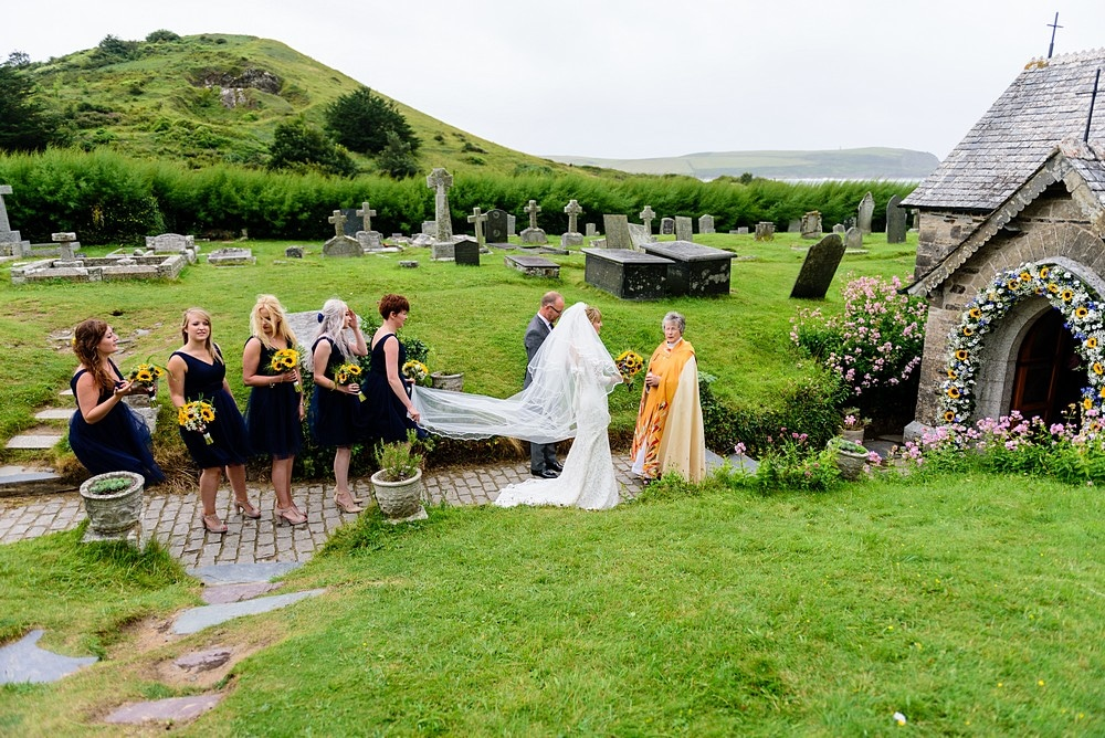 Bride about to walk into St Enodoc's Church