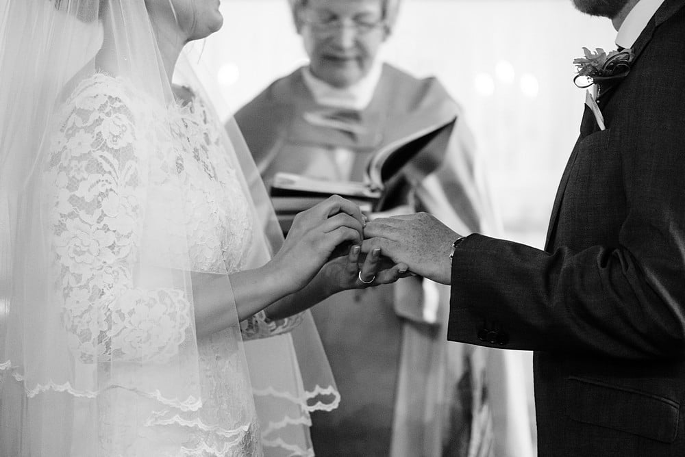exchange of the wedding rings at St Enodoc church 52