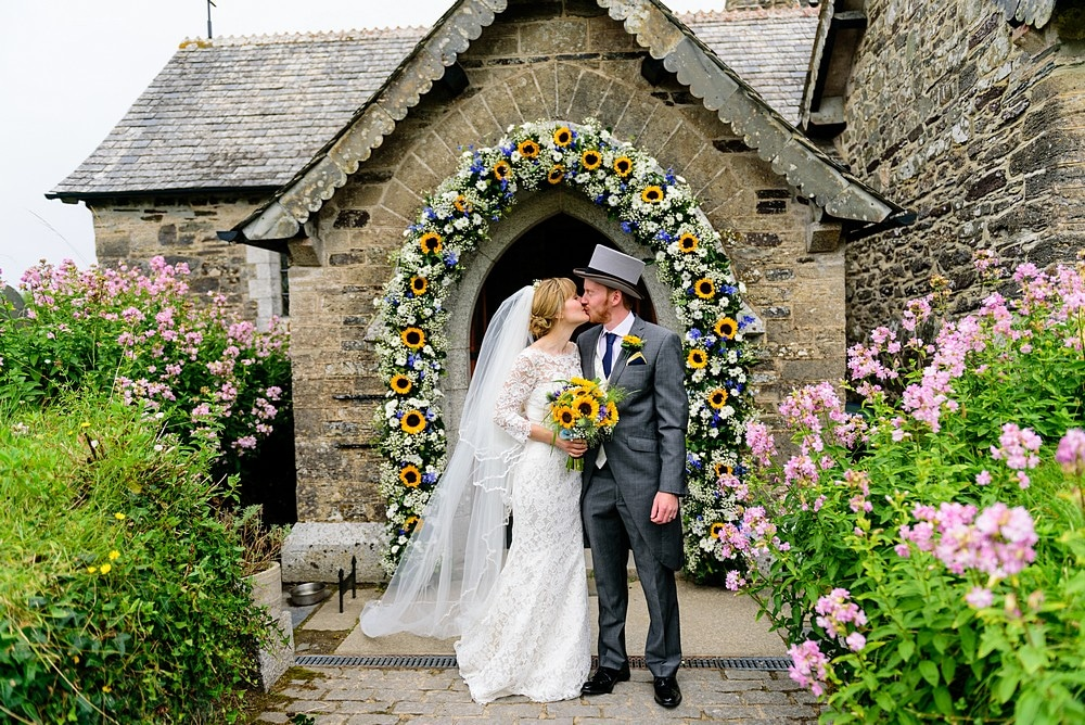 Bride and groom outside St Enodoc Church 57