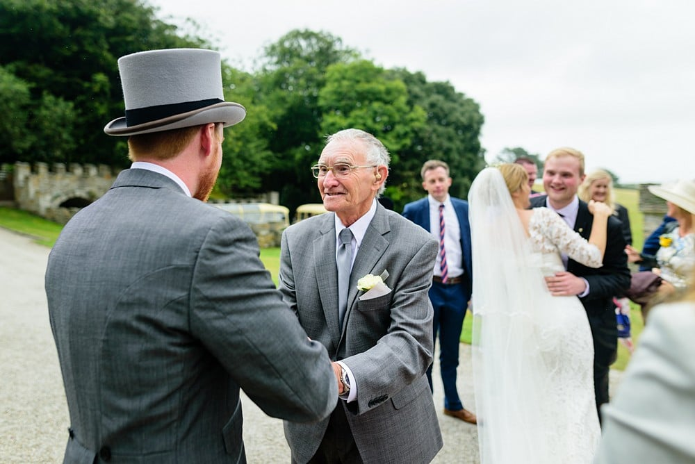 Groom greeting her guests at Prideaux Place 95
