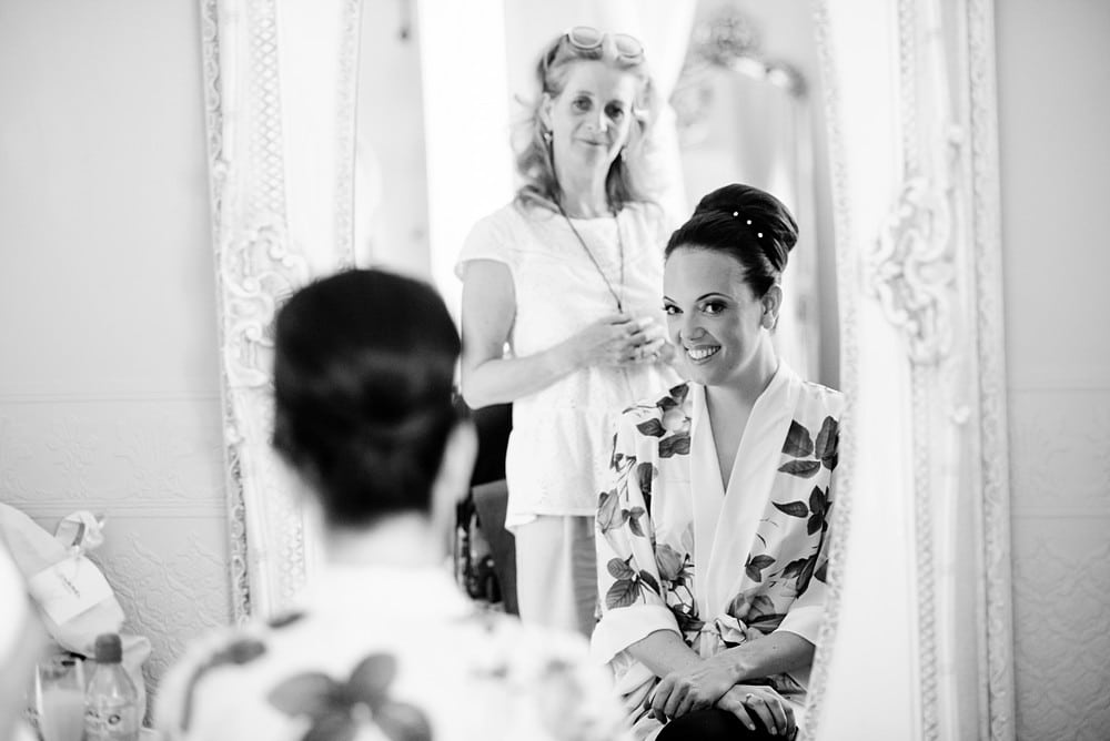 Bride having her hair done at Chateau Forge Du Roy 26