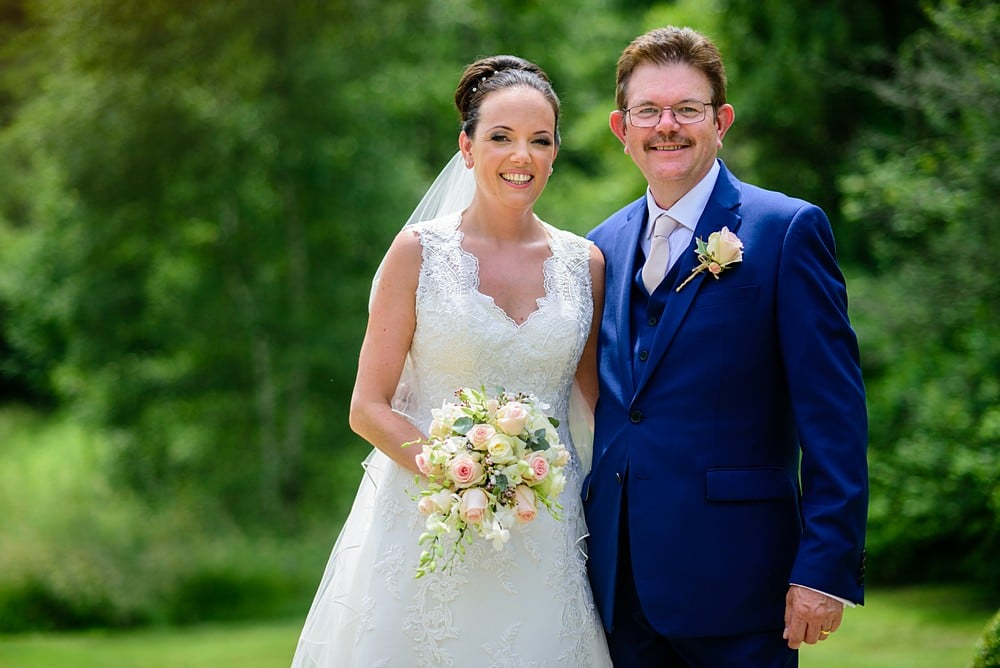Bride and her dad at Chateau Forge Du Roy 38
