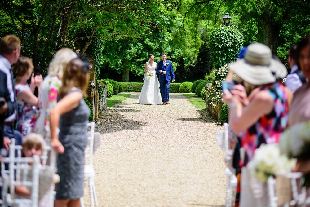 Bride walking down the aisle at Chateau Forge Du Roy 43