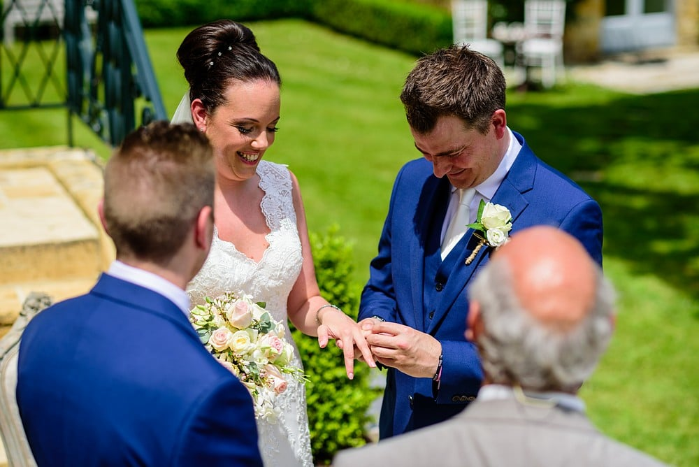 Exchange of rings at Chateau Forge Du Roy wedding 50