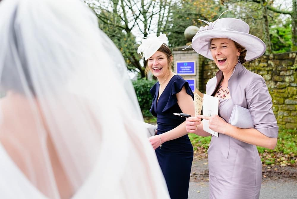 Big laughs from wedding guests at Ludgvan Church