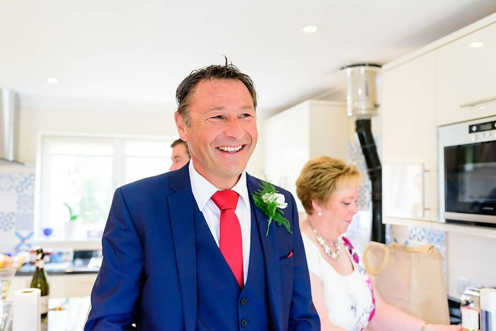 Big smiles from the father of the bride at a St Ives Harbour Hotel wedding